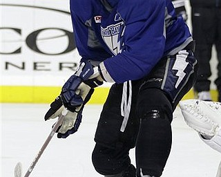 Tampa Bay Lightning center Steven Stamkos attempts to deflect a puck during hockey practice for their first-round NHL playoff series against the Pittsburgh Penguins Tuesday, April 12, 2011 in Tampa, Fla.  Game One of the best-of-seven series begins Wednesday night in Pittsburgh.