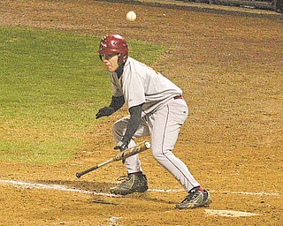 Cardinal Mooney batter Vic Kuchmaner tries to lay down a bunt during Monday night's game against Ursuline in Struthers.