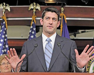 In this April 13, 2011 file photo, House Budget Committee Chairman Paul Ryan, R-Wis. gestures during a news conference at the Capitol in Washington. Standard & Poor's Ratings Service downgraded its outlook Monday on the United States' sovereign debt, expressing unprecedented doubts over the ability of Washington to bring the massive federal budget deficits under control in the next three years.  He is flanked by Rep. Diane Black, R-Tenn., left, and Rep. Jeb Hensarling, R-Texas, right.