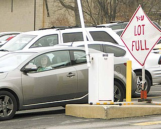 Parking spaces on YSU's campus filled up quickly at several locations Monday. The 1,300-space Lincoln Avenue parking deck closed Monday for repairs and is scheduled to reopen Aug. 29.