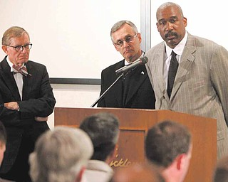 In this March 8, 2011 file photo, Ohio State athletic director Gene Smith, right, takes questions during a news conference with university president E. Gordon Gee, left, and football coach Jim Tressel, center, in Columbus, Ohio. Smith, unable to talk about the ongoing NCAA investigation, does touch upon some fine points of the suspensions of football coach Jim Tressel and five of his players.