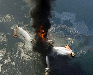 FILE - This April 21, 2010, file photo show the Deepwater Horizon oil rig burning after an explosion in the Gulf of Mexico, off the southeast tip of Louisiana. BP, the oil giant at the center of one of the world's biggest environmental crises, is making strong profits again, its stock has largely rebounded, and it is paying dividends to shareholders once more. It is also pursuing new ventures from the Arctic to India. It is even angling to explore again in the deep waters of the Gulf of Mexico, where it holds more leases than any competitor.