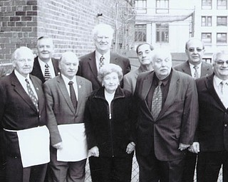 Among those involved in replacing the cornerstone at the Masonic Temple on Wick Avenue are, in front from left, Howard C. Bodine Jr., Emanuel J. Cominos, Elberta Scott, Timothy A. Johnson and John Molnar, and in back, James C. Kowacich Jr., William C. Bell, Richard S. Rosine, Russell W. Gillam Jr., Jack L. Maxwell and William M. Weems.