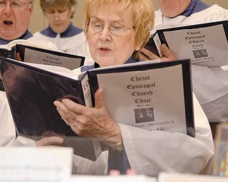 """At a recent practice, Maryanne Stefanick of Cortland rehearses with fellow choir members for the """"Colors of Grace"""" cantata. The cantata tells the story of the Passion of Christ through color, music, lyrics and narrative."""