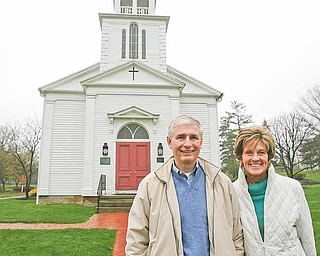Tom and Jane Masters stand in front of St. James Meeting House in Boardman Township Park. Tom's dad, Thomas Masters, was instrumental in getting the structure moved to the park from it's former location, the site of the Southern Park Mall.