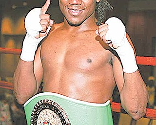 """WBC lightweight champion Dannie Williams will be the first local fighter to fight in a bout organized by the Kelly Pavlik-Jack Loew-owned """"Ghostly Promotions."""""""