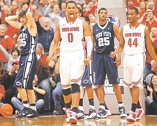 Ohio State's Jared Sullinger (0) reacts after scoring a basket as Penn State's Billy Oliver (35), Cammeron Woodyard (25) and Ohio State's William Buford (44) look on in the closing second of the second half of an NCAA college basketball game Saturday, Jan. 15, 2011, in Columbus, Ohio. Ohio State won 69-66.