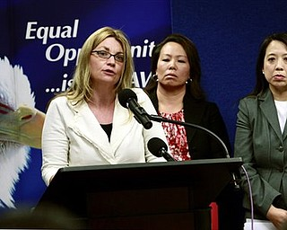 Kay Buck, left, executive director of the Coalition to Abolish Slavery Trafficking, speaks at a news conference Wednesday, April 20, 2011, to announce the filing of a human trafficking lawsuit that stretches  across California , Hawaii, and Washington.  Anna Park, regional attorney for the EEOC in the Los Angeles District, center, and Chanchanit Martorell, executive director for the Thai Community Development Center, listens in.