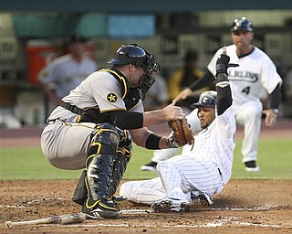 Florida Marlins' Emilio Bonifacio, right, slides in safe at home as the Pittsburgh Pirates catcher Chris Snyder is unable to tag him out after during the second inning of a baseball game at Sun Life Stadium in Miami, Wednesday, April 20, 2011.