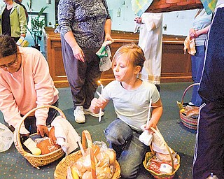 Allyson Smith, 9, of Austintown blows out a candle from the blessing.