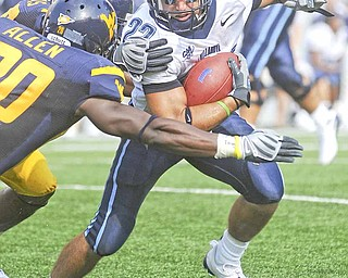 Villanova's Angelo Babbaro (22) looks to run by West Virginia's Franchot Allen (20) during the second quarter of a football game Saturday, Aug. 30, 2008 in Morgantown, W.Va.