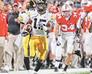 Iowa's Derrell Johnson-Koulianos (15) return a kickoff 99-yards for a touchdown during the fourth quarter of an NCAA college football game against Ohio State, Saturday, Nov. 14, 2009, in Columbus, Ohio.