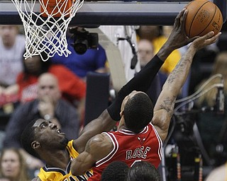 Indiana Pacers' Roy Hibbert, left, blocks the shot of Chicago Bulls' Derrick Rose  during the second half of Game 4 of a first-round NBA basketball series in Indianapolis, Saturday, April 23, 2011. Indiana won 89-84.