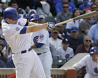 Chicago Cubs' Jeff Baker hits a two-run double against the Los Angeles Dodgers during the eighth inning of a baseball game on Saturday, April 23, 2011, in Chicago.