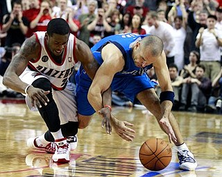 Portland Trail Blazers' Wesley Matthews, left, knocks the ball away from Dallas Mavericks' Jason Kidd , right, in the fourth quarter of Game 4 of their NBA basketball first-round playoff series on Saturday, April 23, 2011, in Portland, Ore. The Trail Blazers defeated the Mavericks 84-82.