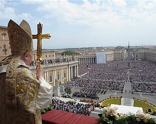 """In this photo provided by the Vatican newspaper L'Osservatore Romano, Pope Benedict XVI holds his pastoral staff during the """"Urbi et Orbi"""" (Latin for to the City and to the World) message from the balcony of St. Peter's Basilica, at the end of the Easter Mass in St. Peter's Square, at the Vatican, Sunday, April 24, 2011. Benedict XVI urged an end to fighting in Libya, using his Easter Sunday message to call for diplomacy and peace in the Middle East."""