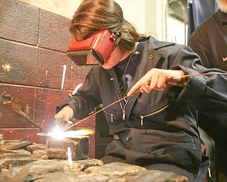 ROBERT K. YOSAY | THE VINDICATOR..Taralynn Gilkinson a senior  gas welds a piece of metal as part of her class project in Mr Bob Day's Welding Class - ..-30-