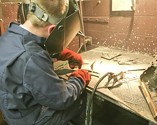 ROBERT K. YOSAY | THE VINDICATOR..Michael Cherol test welds two pieces of metal -  .-30-