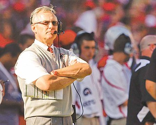 """This Sept. 25, 2010, file photo shows Ohio State's coach Jim Tressel on the sideline during an NCAA college football game against Eastern Michigan, in Columbus, Ohio. The NCAA is accusing Tressel of lying to hide violations by players who traded memorabilia for cash and tattoos.  In a """"notice of allegations"""" sent to the school, the NCAA said Monday, April 25, 2011,  that the alleged violations relating to the coach are considered """"potential major violations."""""""