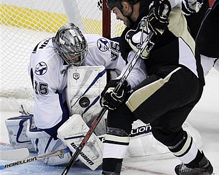 Pittsburgh Penguins' Craig Adams, right, can't get a shot past Tampa Bay Lightning goalie Dwayne Roloson (35) in the third period of Game 5 of a first-round NHL Stanley Cup playoff series in Pittsburgh Saturday, April 23, 2011. The Lightning won 8-2.
