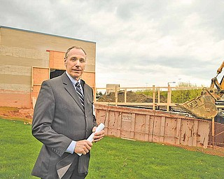 Wayne Tennant, vice president of support services for Humility of Mary Health Partners, is at the construction site of St. Elizabeth Health Care Center's $8 million Joanie Abdu Comprehensive Breast Care Center in Youngstown.