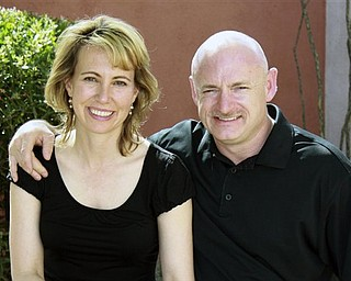 This undated file photo provided by the office of Rep. Gabrielle Giffords, shows Giffords, left, with her husband, NASA astronaut Mark Kelly. Giffords will attend her husband's space shuttle launch in Florida on Friday, Kelly said, allowing the Arizona congresswoman to travel for the first time since she was flown from Tucson to Houston more than three months ago to recover from a gunshot wound to the head.
