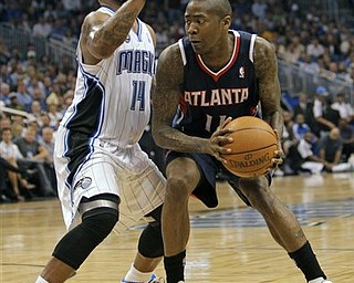 Atlanta Hawks' Jamal Crawford, right, looks to pass the ball past Orlando Magic's Jameer Nelson (14) during the first half of Game 5 of a first-round NBA playoff basketball series in Orlando, Fla., Tuesday, April 26, 2011.