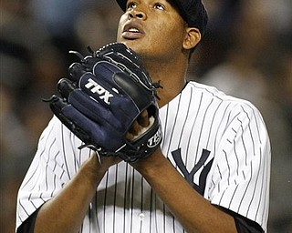 New York Yankees starting pitcher Ivan Nova looks to the sky while coming off the mound in the seventh inning after manager Joe Girardi took him out of the baseball game against the Chicago White Sox at Yankee Stadium on Tuesday, April 26, 2011, in New York.