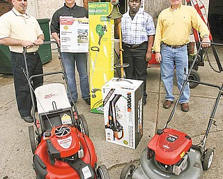From left, the Rev. Al Yanno of Metro Assembly of God; Jim Lipjanic, co-owner of City Wide Lawn Equipment on Southern Boulevard; Travis Ranshaw, the church's junior high pastor; and Mike Vargo, City Wide co-owner, show the donation of lawn mowers, leaf blowers and weed whackers to the church.