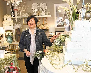 Linda Fowler of Poland shows off merchandise in her newly opened South Main Street wedding-planning business, Black Dog: Wedding and Special Event Design. The shop is designed to help brides bring to life the vision they have of their big day.