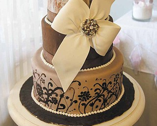 This wedding cake greets customers as they enter Black Dog: Wedding and Special Event Design in Poland.