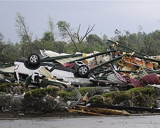 The remains of Hill's Carpet Center in Concord Ala., are seen after what appeared to be a tornado ripped through parts of the town late Wednesday, April 27, 2011. The damage in the area is extensive with homes and businesses destroyed and people injured.  (AP Photo/Birmingham News, Jeff Roberts)