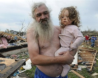 Willie Hyde holds his grand daughter 2-years-old Sierra Goldsmith near where their house stood in Concord Ala., after what appeared to be a tornado ripped through parts of the town late Wednesday, April 27, 2011. The damage in the area is extensive with homes and businesses destroyed and people injured.  (AP Photo/Birmingham News, Jeff Roberts)
