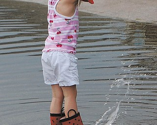 Making a little splash in the aftermath of a rainstorm in May 2010 is Allison Jones, 5, of Canfield. Photo was taken by her mom, Sally Jones.