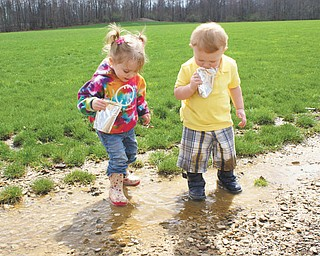 At a recent NSS Assembly 731 Easter Egg Hunt at the Poland Township Park, 2-year old cousins Samantha Cannon and Brady Lewis found dancing in the puddles from this year's April showers to be more fun than the Egg Hunt. Samantha's parents are Kim and Michael Cannon of Poland, and Brady's parents are Leslie and Chuck Lewis of New Middletown. Photo submitted by Laurie Fox of Lowellville.