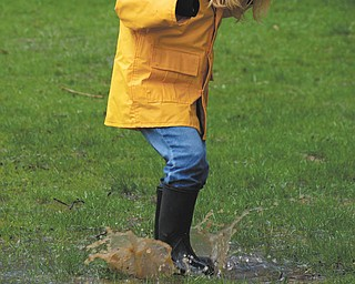3-year old Ashlynn Mason of Salem enjoys jumping in puddles while visiting with her parents, Beth and Matthew Mason, on a warm, rainy day at Grandma Laurie and Grandpa Mike Fox's home in Poland Township. Photo submitted by Laurie Fox of Lowellville.