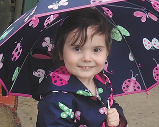 Carley Johnston, 5, of Poland had a great time playing outside in the drizzle during a recent April shower. She loved wearing her matching rain gear! Photo taken by her mom, Cara Johnston.