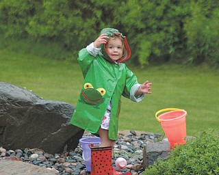 Ella Nagy of North Lima was 3 at the time this picture was taken of her playing in the rain.