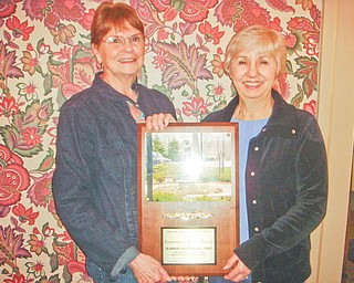 Community Pride Award: Upton Association Board members Sally Mazer, left, and Sue Olson proudly hold the association's latest award, presented by the Warren Area Board of Realtors. The Upton Association was chosen for the Community Pride Award for its efforts in creating and maintaining the Women's Park in Warren, directly across from Upton House, which is at 380 Mahoning Ave NW. The house, landmark home of suffragette Harriet Upton, will be the site of many activities in the coming months. For more information phone 330-395-1840 or visit the web at www.uptonhouse.org.