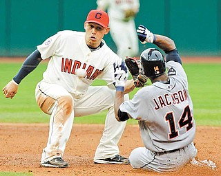 Cleveland Indians shortstop Asdrubal Cabrera takes the throw in time to tag out Detroit Tigers' Austin Jackson (14) trying to steal second base in the third inning of a baseball game Saturday, April 30, 2011, in Cleveland.