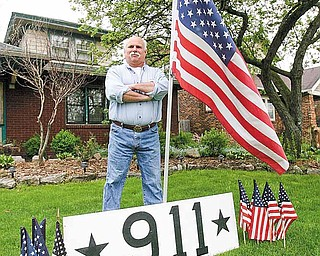 Billy Frease set up a 9/11 memorial Monday in front of his South Side home, the day after it was