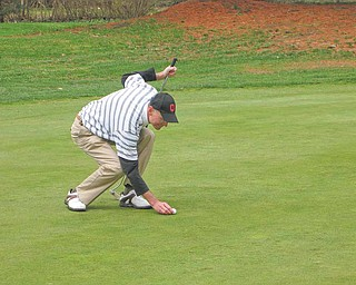 Frank Bellino of Liberty lines up a shot on Stambaugh's venerable No. 1 hole.