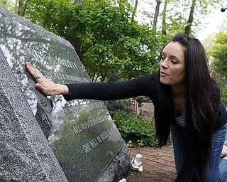 Deena Laverty touches the portrait on a carved stone Monday, May 2, 2011, in Middletown, N.J., that honors her mother , Anna A. Laverty, who was killed in the attacks on the World Trade Center  on Sept. 11, 2001. There are 37 stones in the garden representing those from Middletown who died in the attack. Word came late Sunday, May 1, 2011 that Osama Bin Laden has been killed.