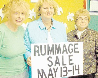 Sign says it all: The Women's Altar and Rosary Guild of St. Thomas the Apostle Catholic Church, 4453 Warren-Sharon Road, Vienna, will sponsor a rummage sale from 10 a.m. to 5 p.m. May 13 and 14. At 2 p.m. Saturday, all merchandise will be half-price. On both days, clothing will be sold for $3 per grocery bag. Some items will be prepriced. Also featured will be a bake sale, a light lunch for sale, free admission and free parking. From left to right, above, are Ann Bosheff, chairwoman of the bake sale; Patty Slavin, project chairwoman; and Barb Obermiyer, kitchen assistant chairwoman.