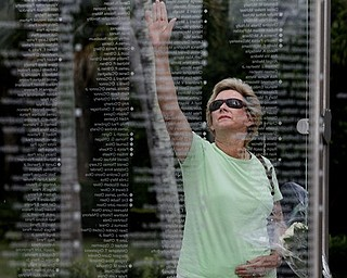 Kathy Maycen reaches to touch the name of her daughter, Lindsay Stapleton Morehouse, who was killed in the attack on the World Trade Center on Sept. 11, 2001, at a memorial in Palm Beach Gardens, Fla., Monday May 2, 2011.  Osama bin Laden, the face of global terrorism and architect of the Sept. 11, 2001, attacks, was killed in a firefight with elite American forces in Pakistan on Monday, then quickly buried at sea in a stunning finale to a furtive decade on the run. (AP Photo/The Palm Beach Post, Lannis Waters) ** MAGS OUT. TV OUT. NO SALES **
