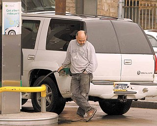 A man pumps gas at a BP gas station Tuesday, May 3, 2011 in Pittsburgh, where regular gas was priced at $4.05, medium at $4.25, and hi-test $4.39. The national average for a gallon of regular was $3.97 on Tuesday _ 32 cents higher than a month ago and $1.07 more than a year ago.