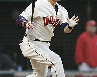 FILE - In this April 30, 2011 file photo, Cleveland Indians' Shin-Soo Choo, of South Korea, hits against the Detroit Tigers in a baseball game in Cleveland. The team said Choo was arrested early Monday, May 2, 2011, in Sheffield Lake, Ohio and charged with drunken driving.
