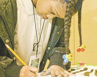 William d Lewis the Vindicator  Taylor Lofton , 3rd grade, works on a project during a family night at Taft School Wed. Curtis is a  kindergarten student at Taft