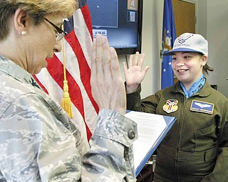 Ashley Moorhead, 11, of Warren, is sworn in as an honorary Air Force second lieutenant by Air Force Reserve Col. Teresa Ham during the 910th Airlift Wing's Pilot for a Day program.