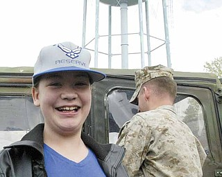 Ashley Moorhead is all smiles in anticipation of a day of activities, including being taxied in a C-130 Hercules cargo plane.